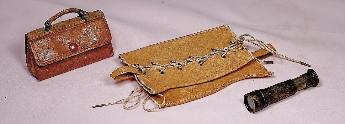 140. DOLL'S SPYGLASS, LEATHER SATCHEL AND GAITERS. 2 ¾""