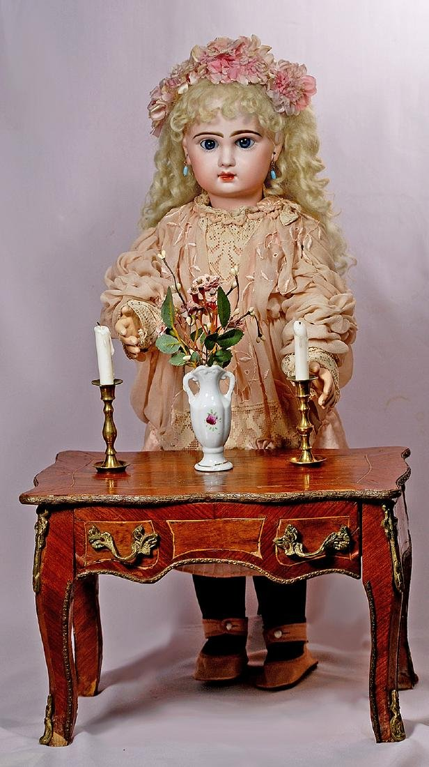 142. DOLL'S FRENCH ROSEWOOD TABLE WITH GILDED TRIM. 13