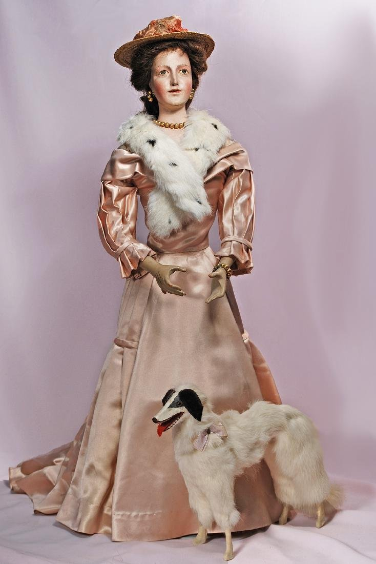 160. EARLY CONTINENTAL WOODEN LADY DOLL WITH REGAL