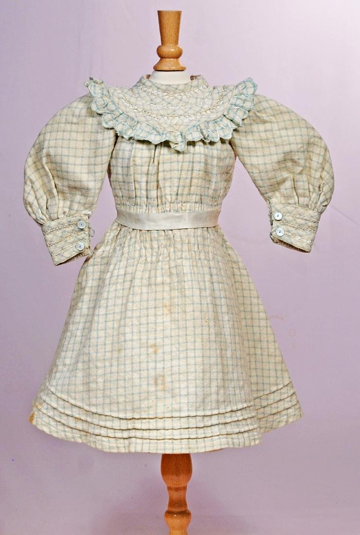 """194. ANTIQUE DOLL DRESS. 5"""" shoulder width; 15 1/2"""""""
