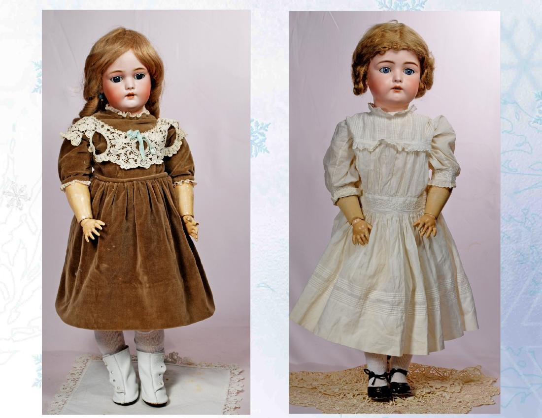 244. TWO GERMAN BISQUE DOLLS. Each has socket head,