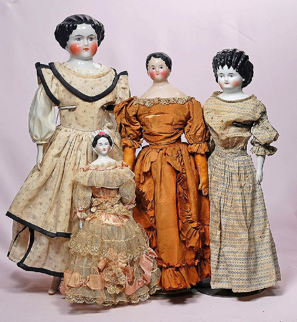 246. FOUR GERMAN PORCELAIN CHINA DOLLS. Including. (1)