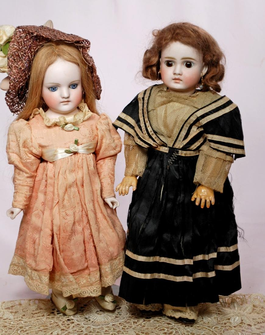252. TWO GERMAN BISQUE CLOSED-MOUTH DOLLS. (1) 14""