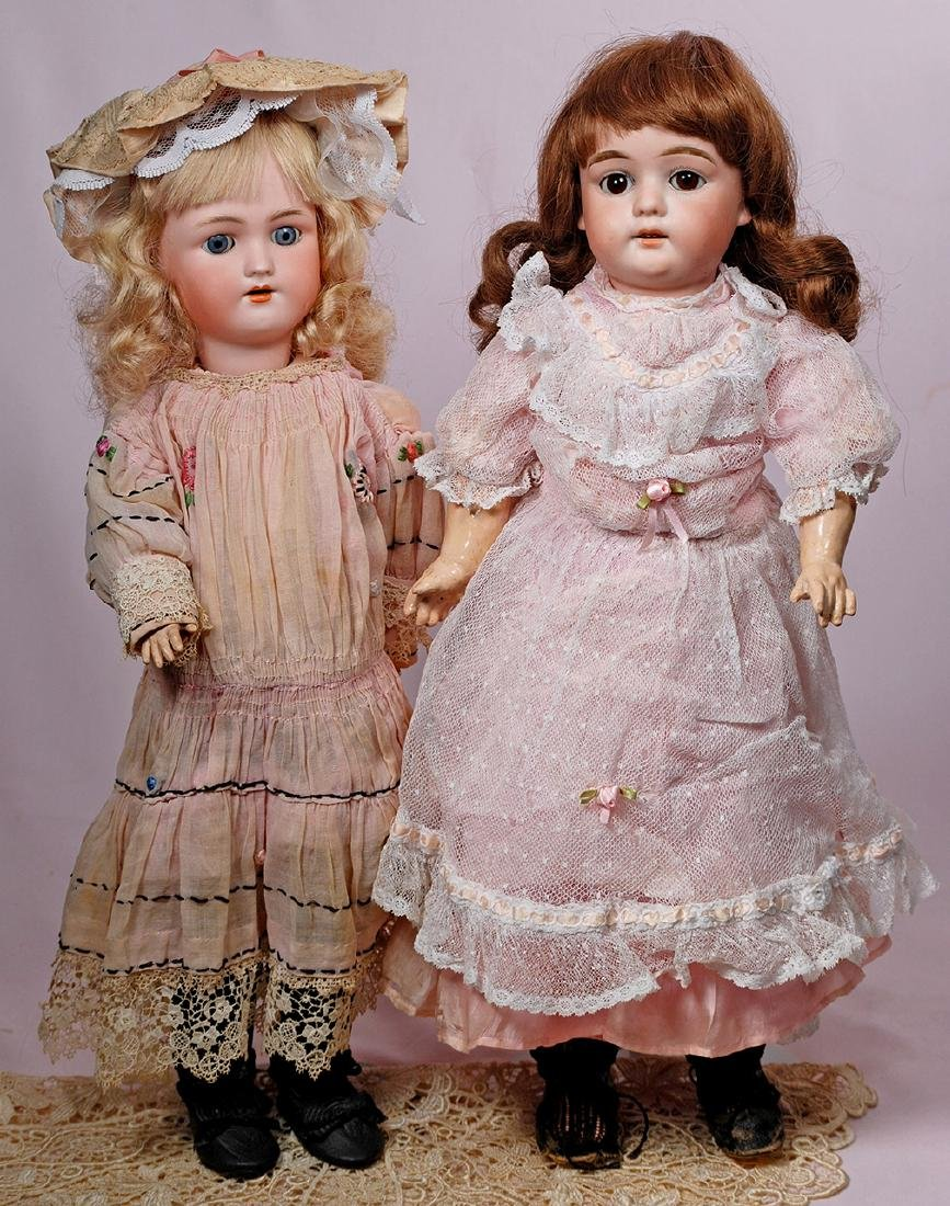 260. TWO GERMAN BISQUE DOLLS. Each has bisque socket