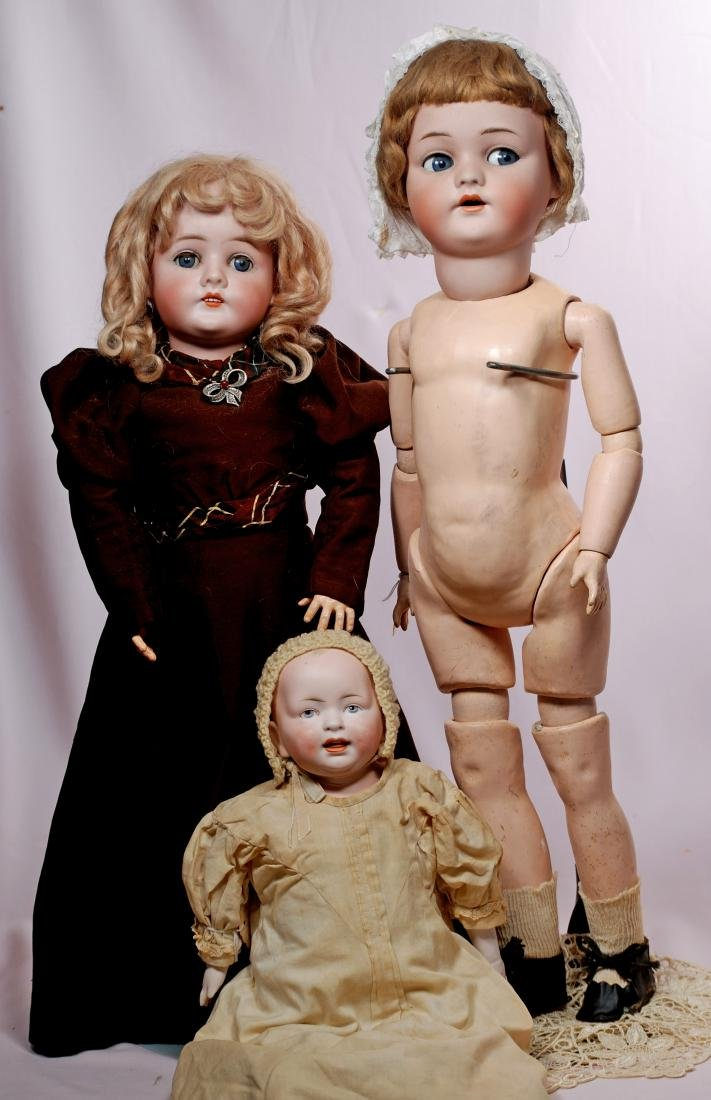 "261. THREE GERMAN BISQUE DOLLS. (1) 21"" marked Queen"