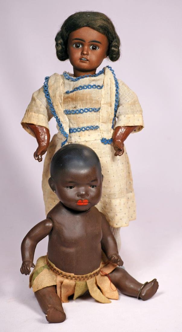 270. TWO GERMAN BISQUE DOLLS WITH BROWN COMPLEXION. (1)