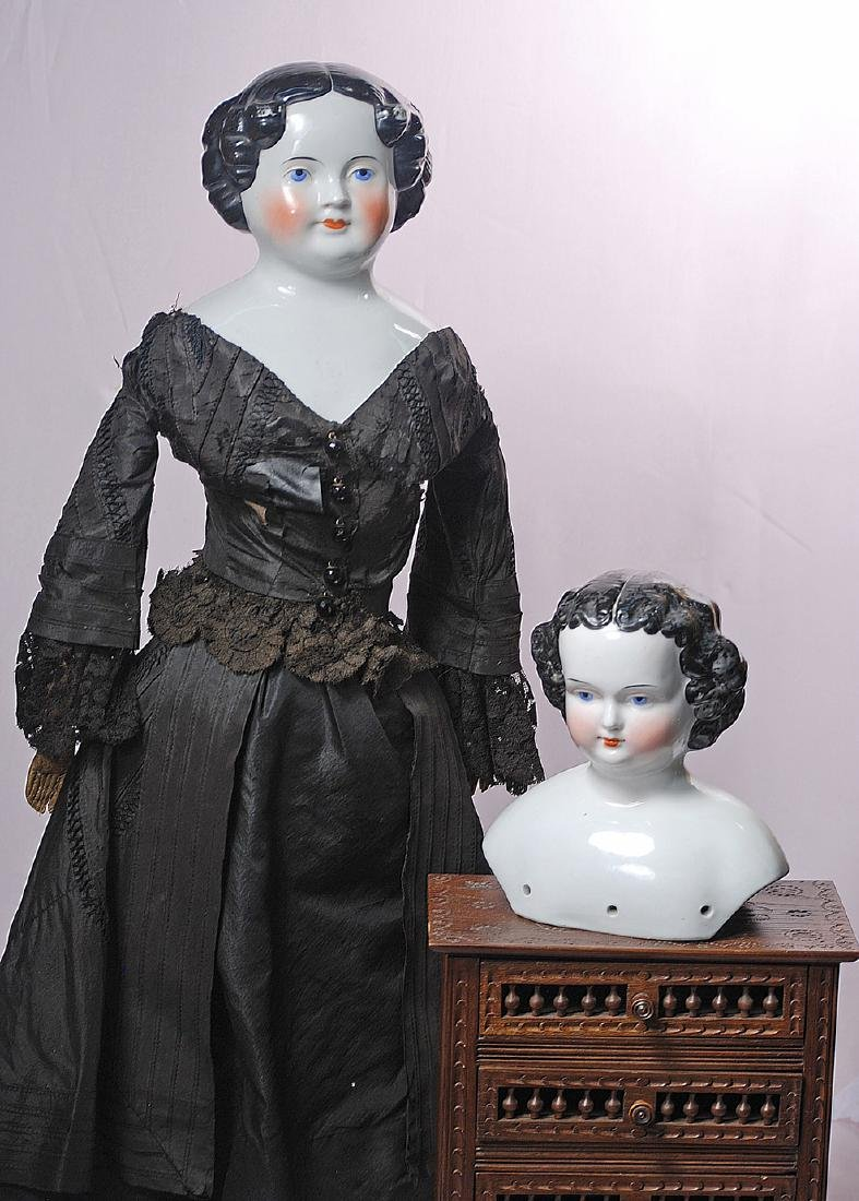 276. TWO CHINA DOLLS. Each is porcelain shoulderhead
