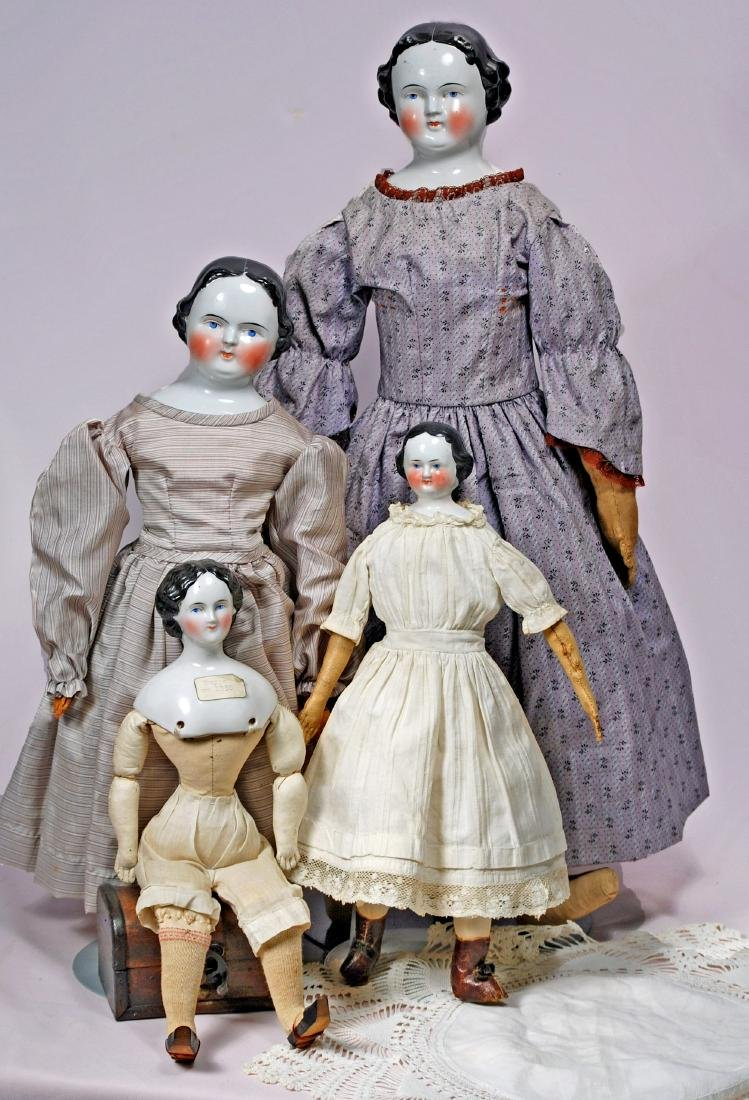 """280. FOUR GERMAN CHINA DOLLS. (1) , 21"""" doll with old"""