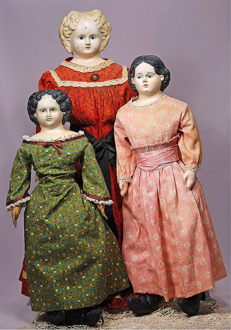 "285. FOUR GERMAN PAPER MACHE GREINER DOLLS. (1) 24"" - 2"