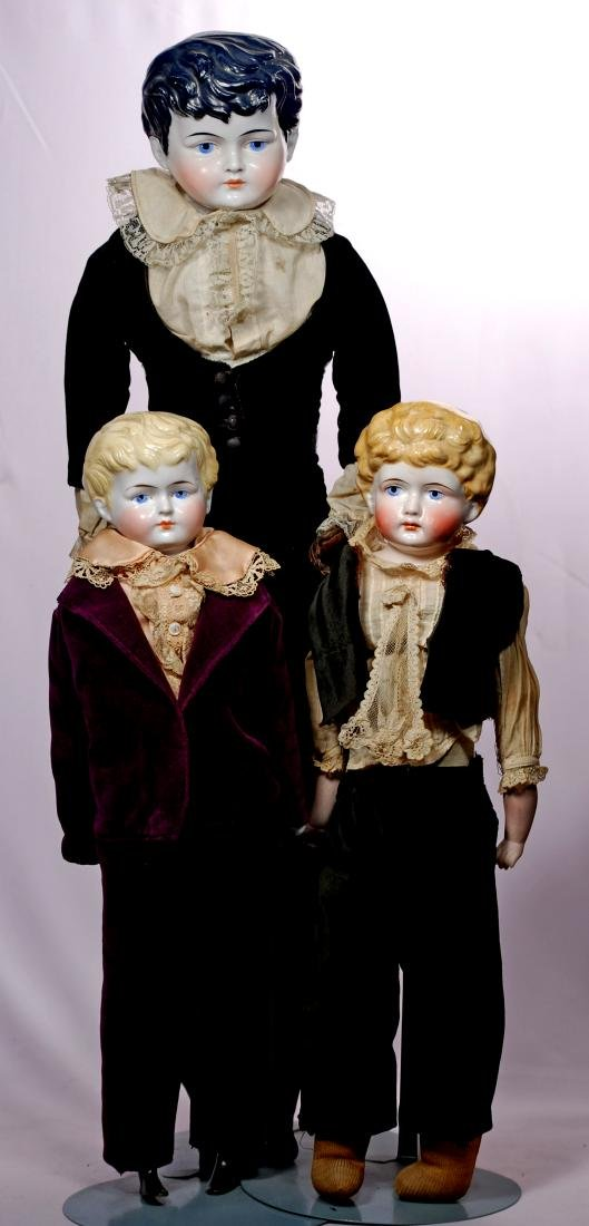 287. THREE GERMAN CHINA GENTLEMEN. Each has porcelain