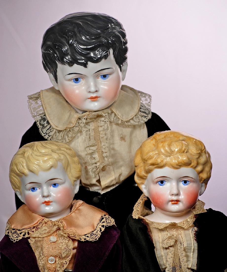 287. THREE GERMAN CHINA GENTLEMEN. Each has porcelain - 2