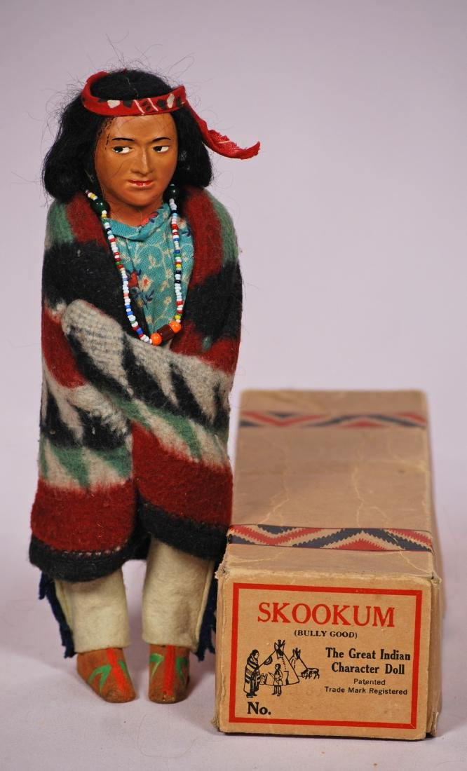"293. MINT-IN-BOX SKOOKUM DOLL. 10 "". Papier mache doll"