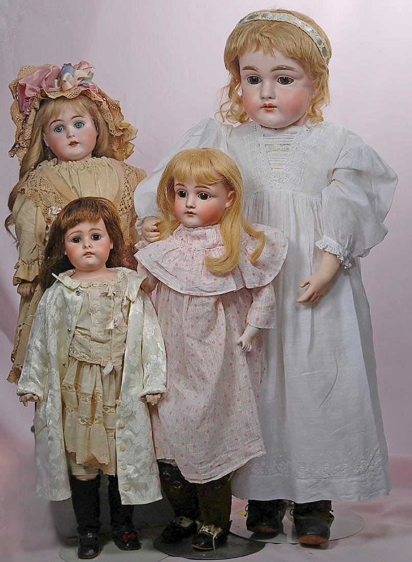294. FOUR GERMAN BISQUE SHOULDERHEAD DOLLS BY KESTNER.