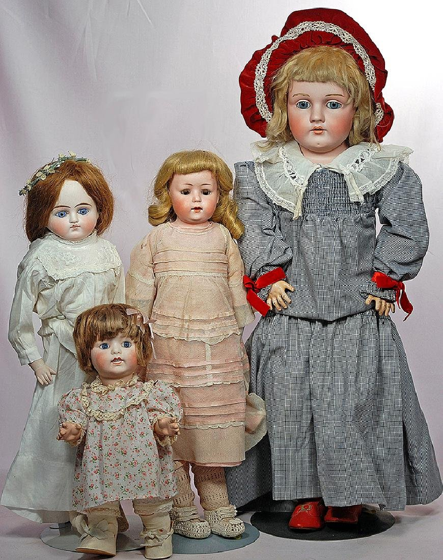 300. FOUR BISQUE DOLLS: FRENCH CHARACTER TODDLER &