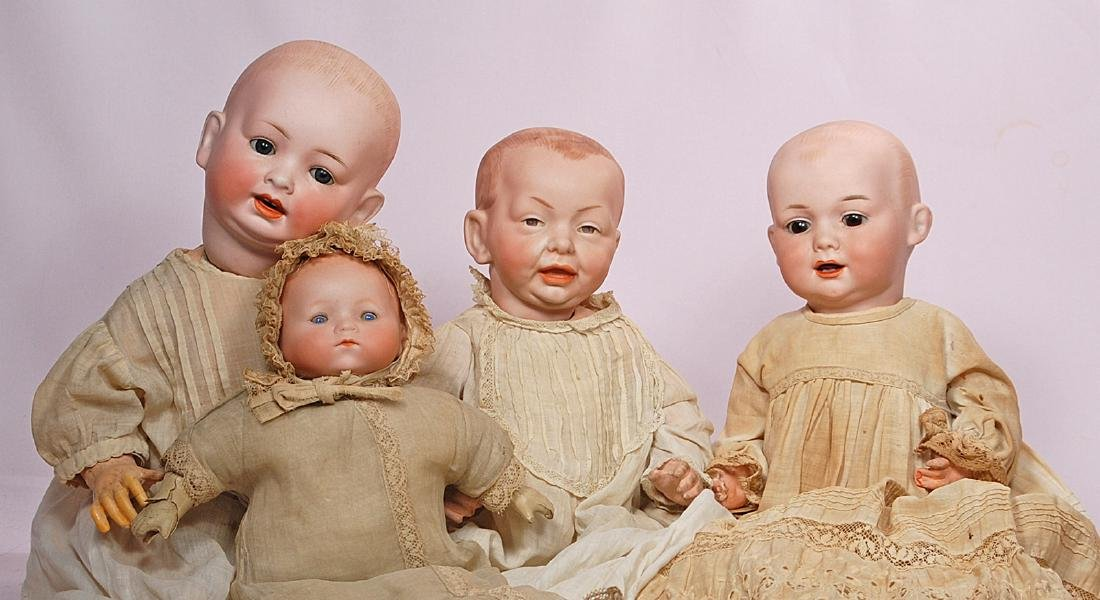 301. FOUR GERMAN BISQUE CHARACTER BABIES. (1) 18""