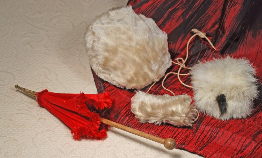 DOLL'S RED PARASOL PLUS WHITE FUR HAT AND MUFFFS.