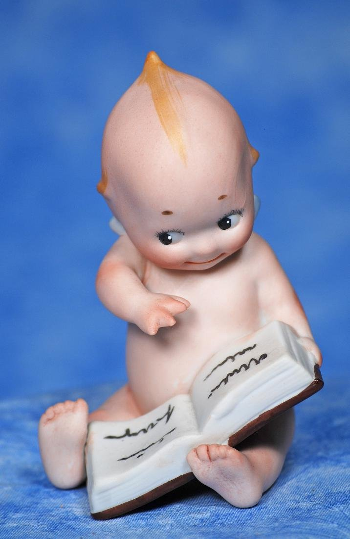 5. GERMAN BISQUE KEWPIE WITH OPEN BOOK. Marks: Black - 2