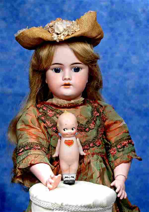 12. GERMAN BISQUE KEWPIE DOLL WITH PAINTED SHOES.