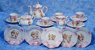 . KEWPIE PORCELAIN TEA SERVICE. Twenty piece white