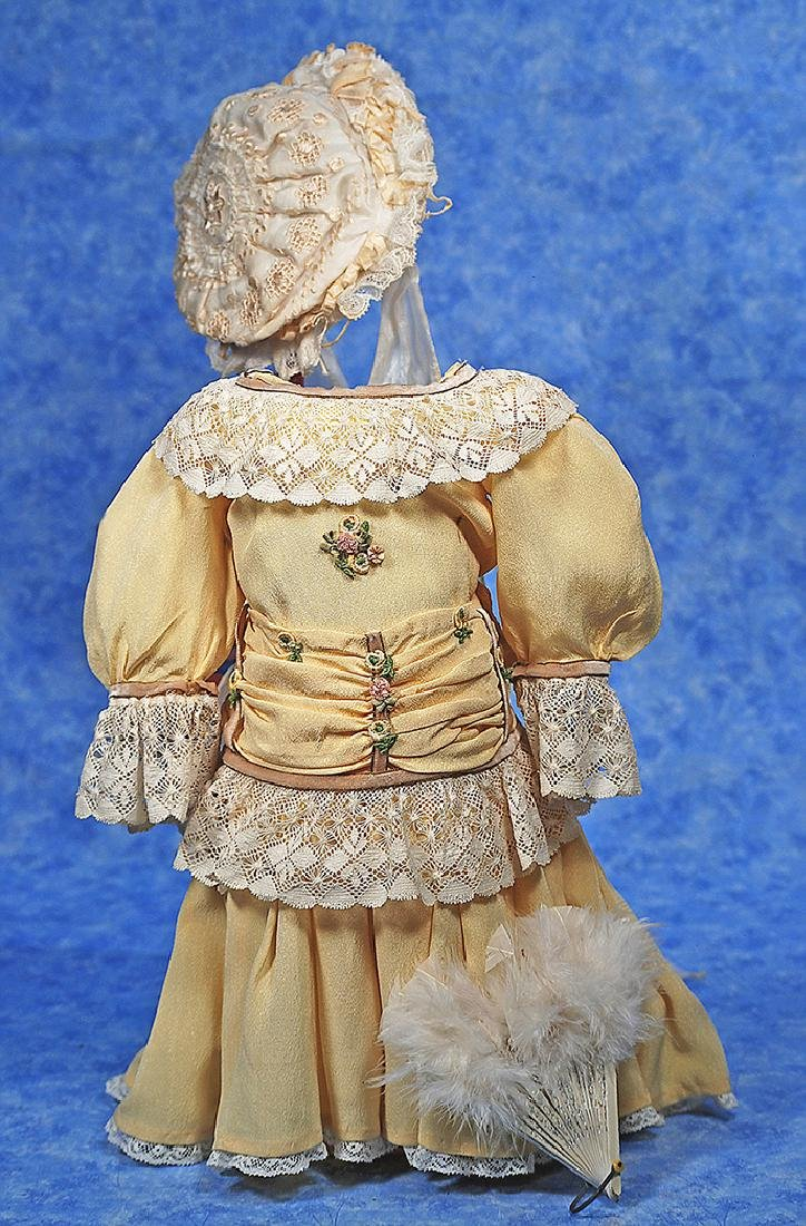 51. DOLL DRESS, BONNET AND FAN. Soft yellow silk crepe