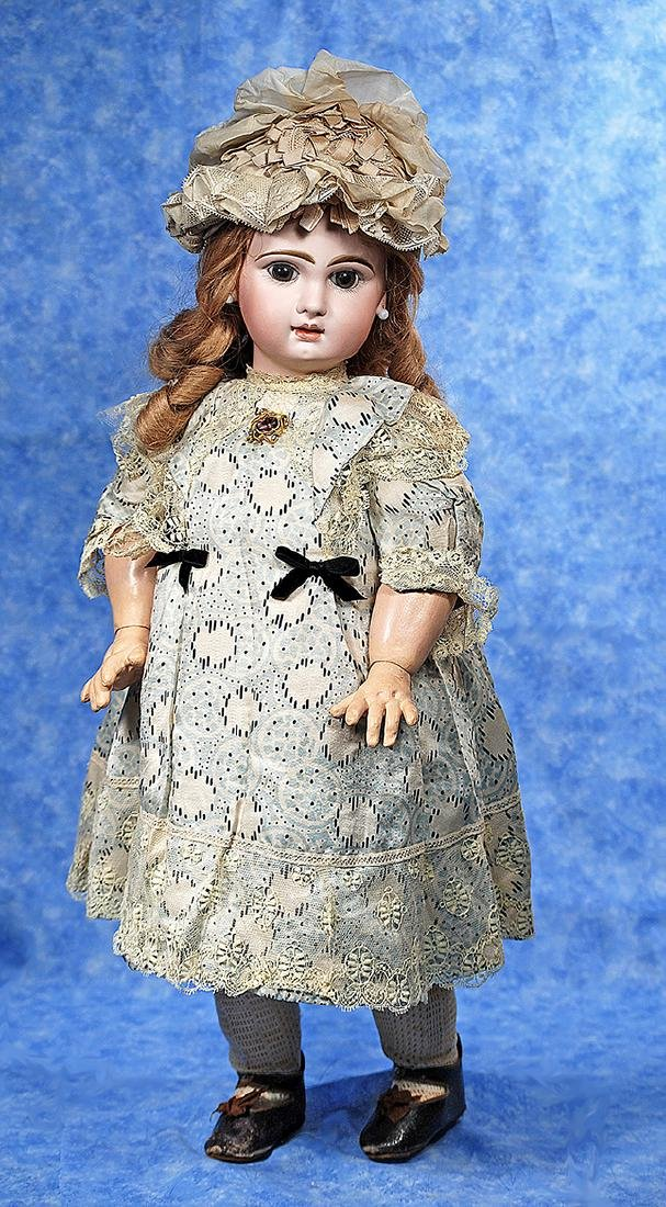53. FRENCH BISQUE BEBE BY JUMEAU IN FACTORY DRESS AND