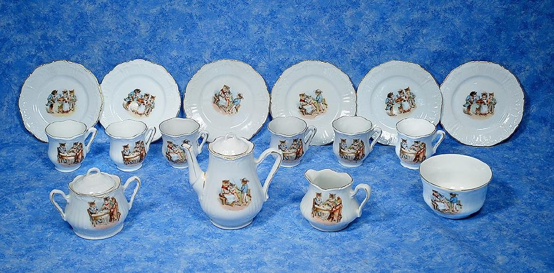 57. GERMAN CHILD-SIZED PORCELAIN DISHES WITH PUSS
