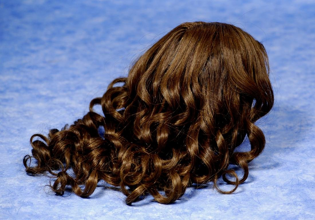 102. ANTIQUE DOLL WIG. Long brunette hand-tied human