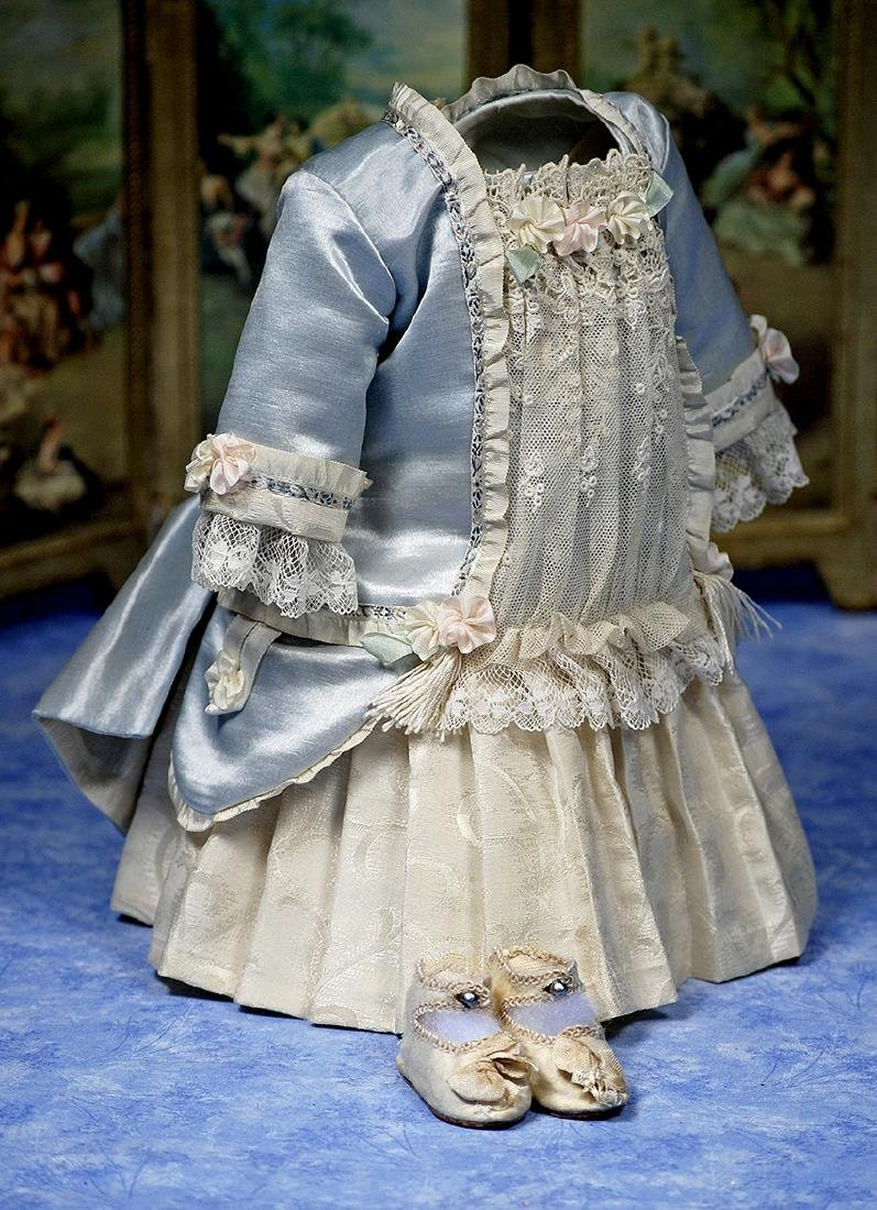 103. DOLL DRESS AND SHOES. Pale blue silk-satin