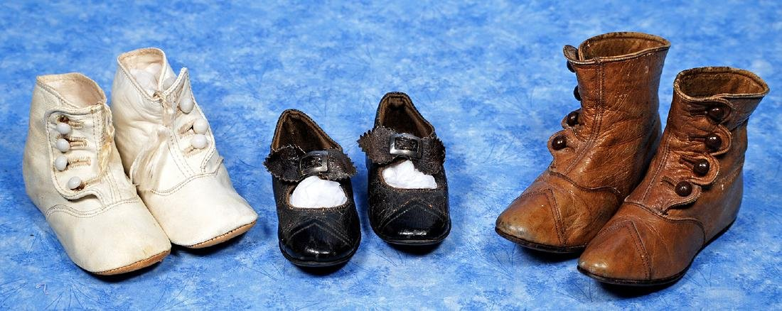 "105. THREE PAIR OF ANTIQUE SHOES. Includes: 5"" L."