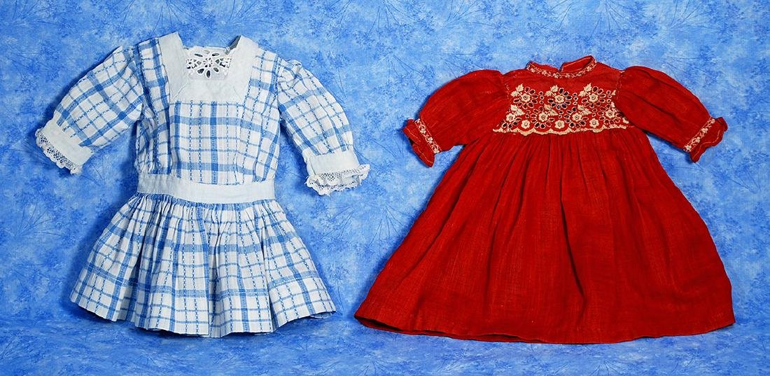 124. TWO ANTIQUE COTTON DOLL DRESSES. (1) Blue and