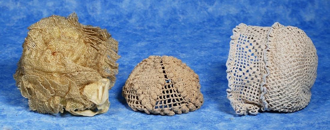 128. SIX DOLL BONNETS. Includes: Cream all-lace bonnet