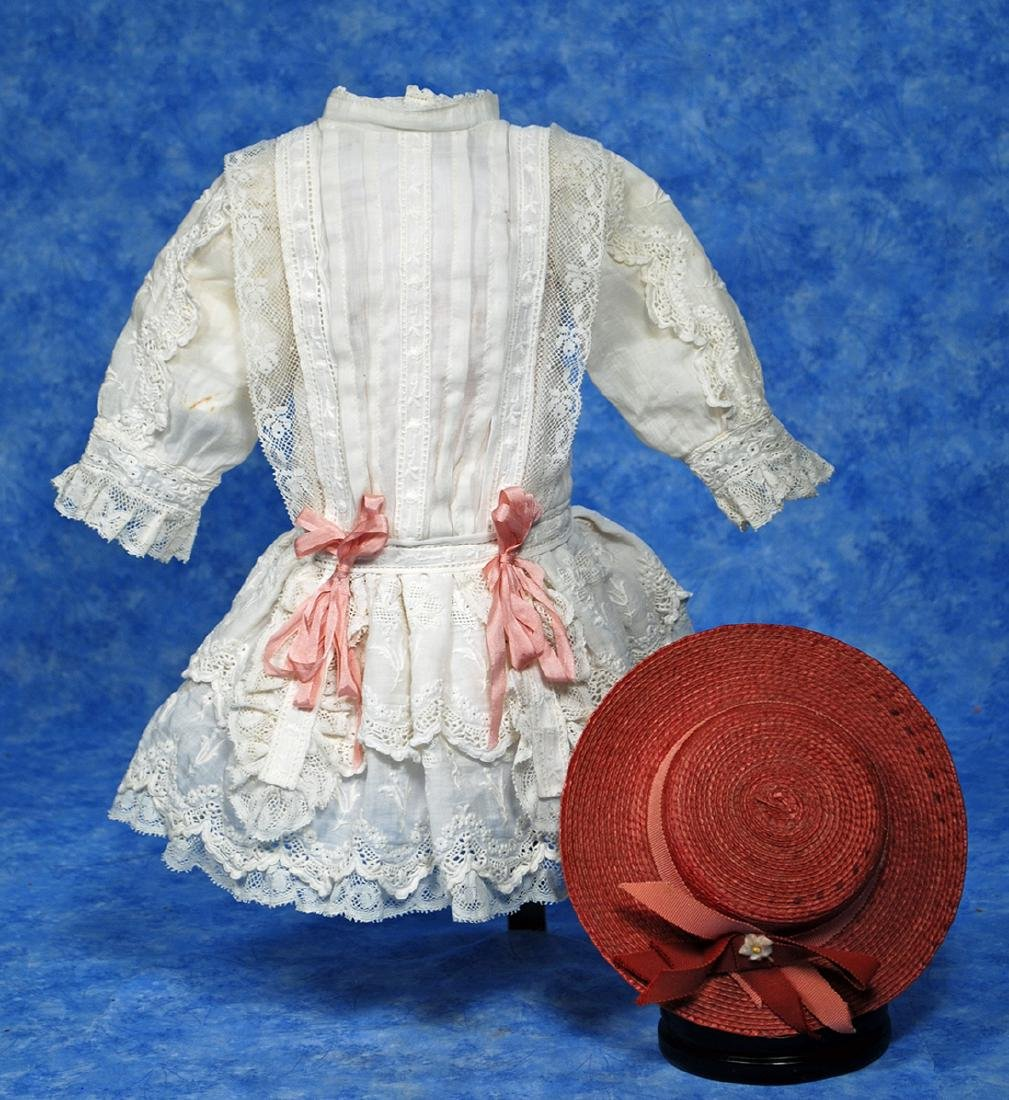 130. ANTIQUE DOLL DRESS AND BONNET. White cotton dress