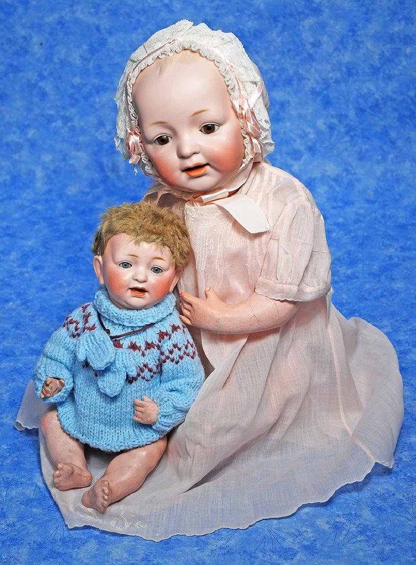 131. TWO GERMAN BISQUE CHARACTER BABIES BY KESTNER.