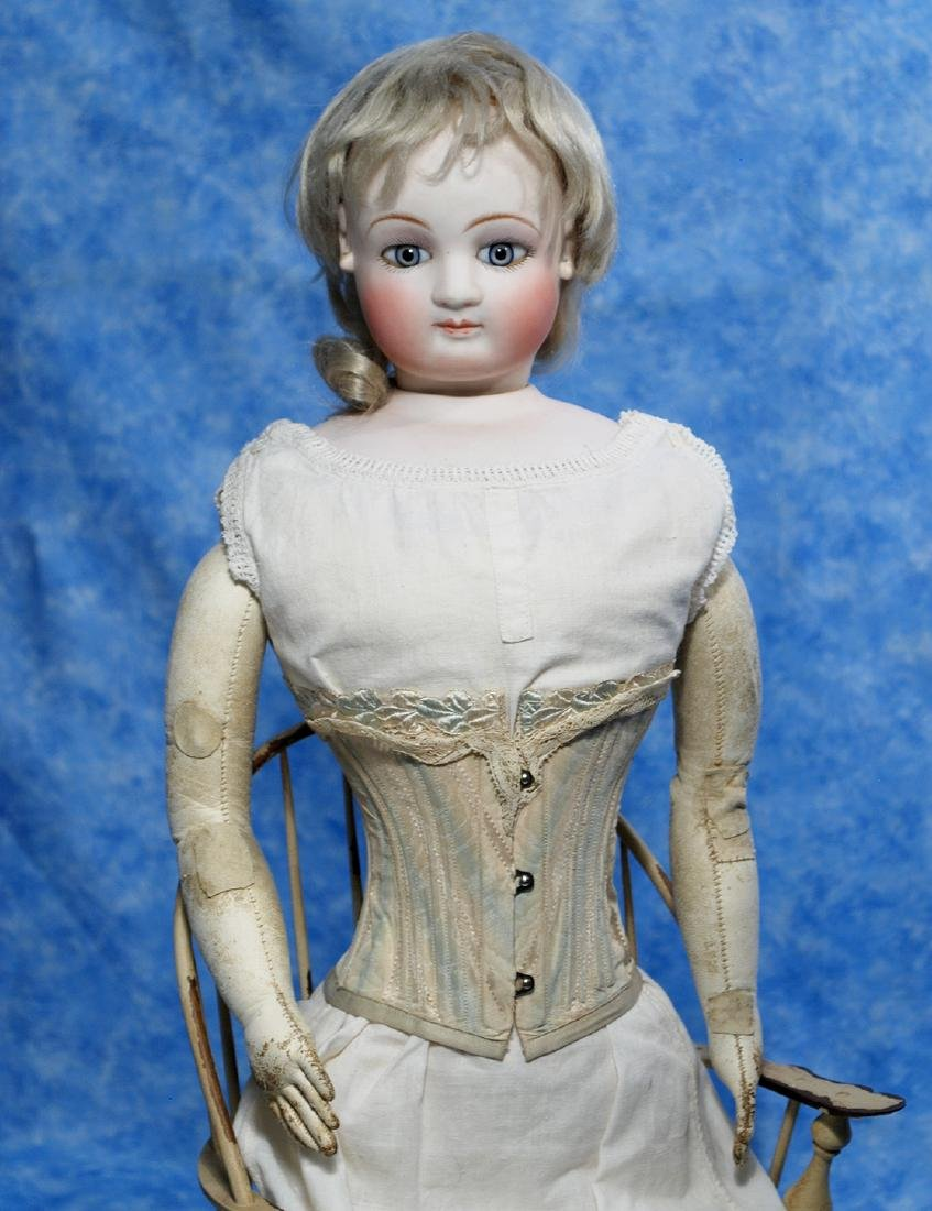 132. FRENCH BISQUE POUPEE WITH BEAUTIFUL FACE. 23""