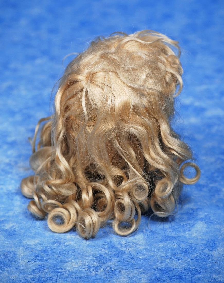 134. ANTIQUE BLONDE MOHAIR WIG. Fine wig of soft blonde