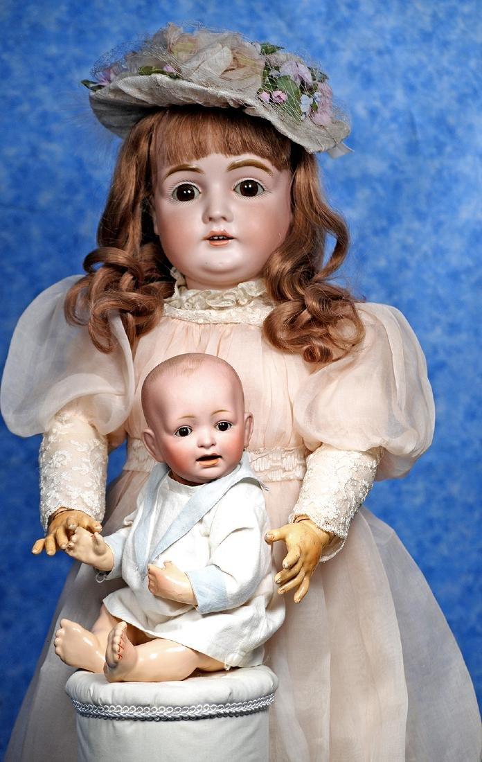144. LARGER GERMAN BISQUE CHILD BY KESTNER. Marks: M.