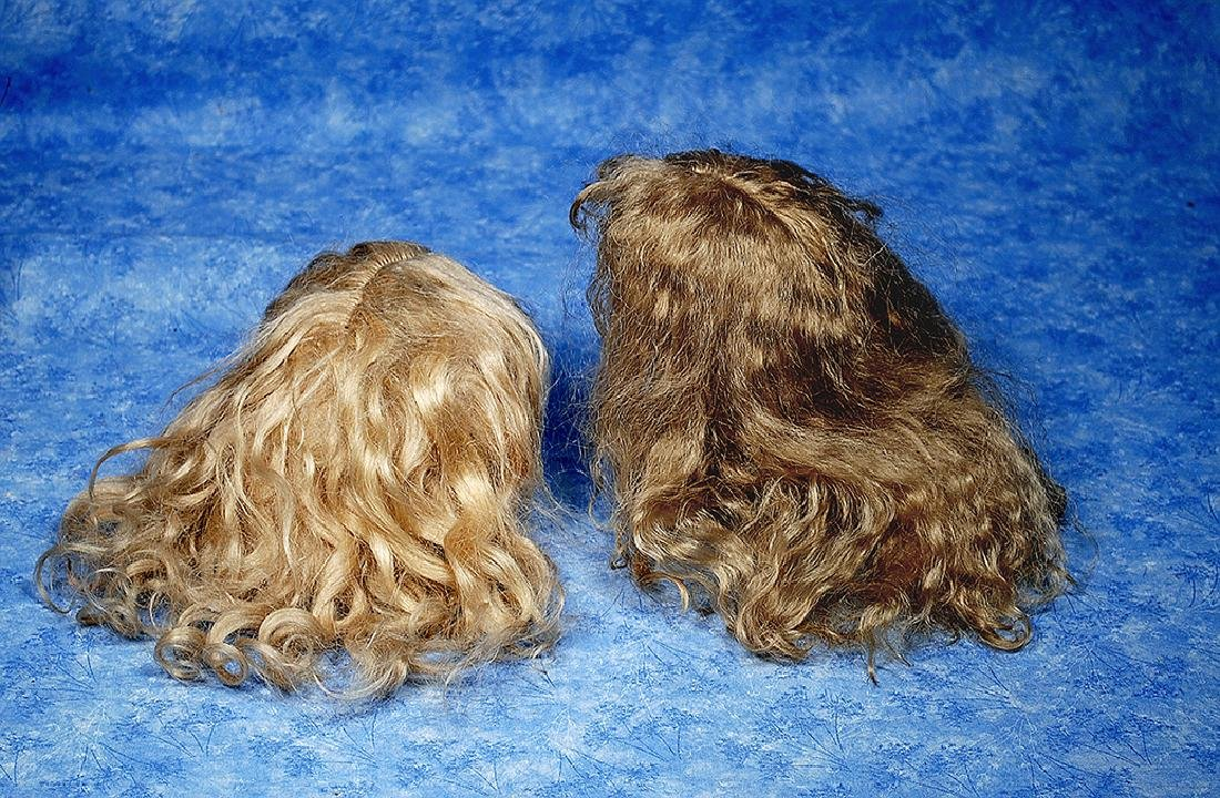 160. TWO MOHAIR DOLL WIGS. (1) Antique blonde mohair