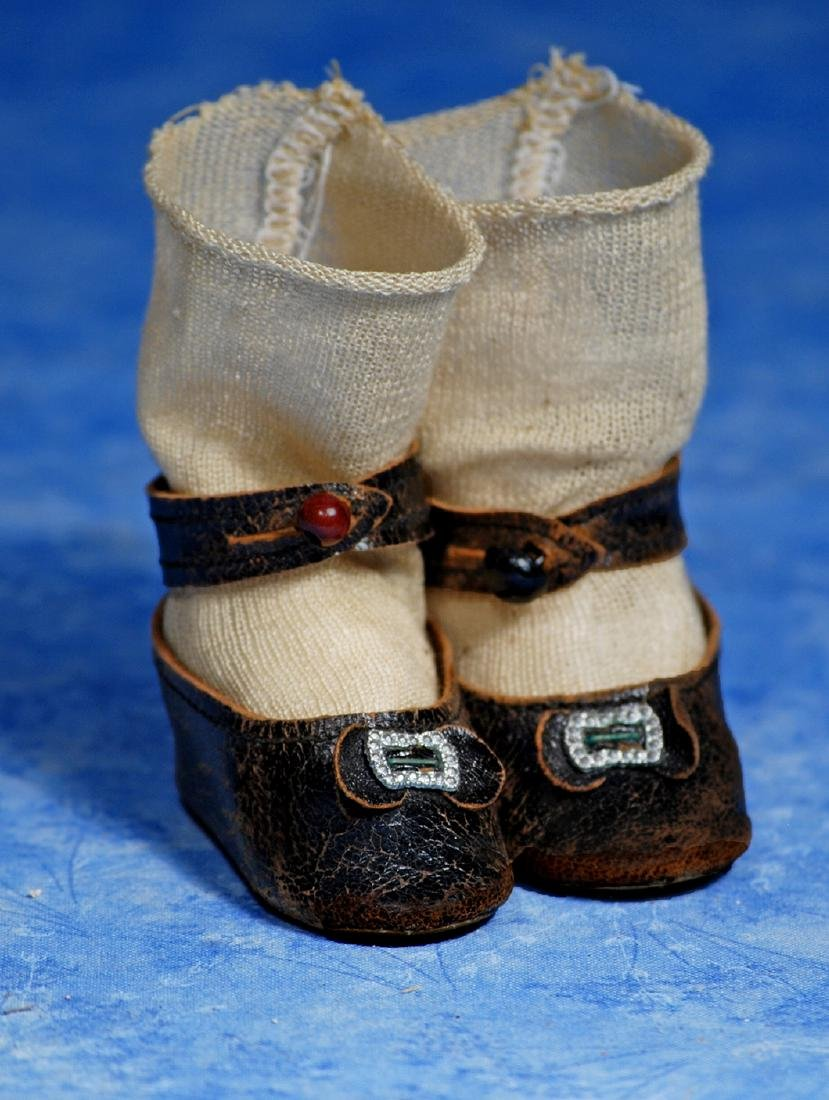 """167. ANTIQUE DOLL SHOES AND SOCKS. 2 ½"""" L."""