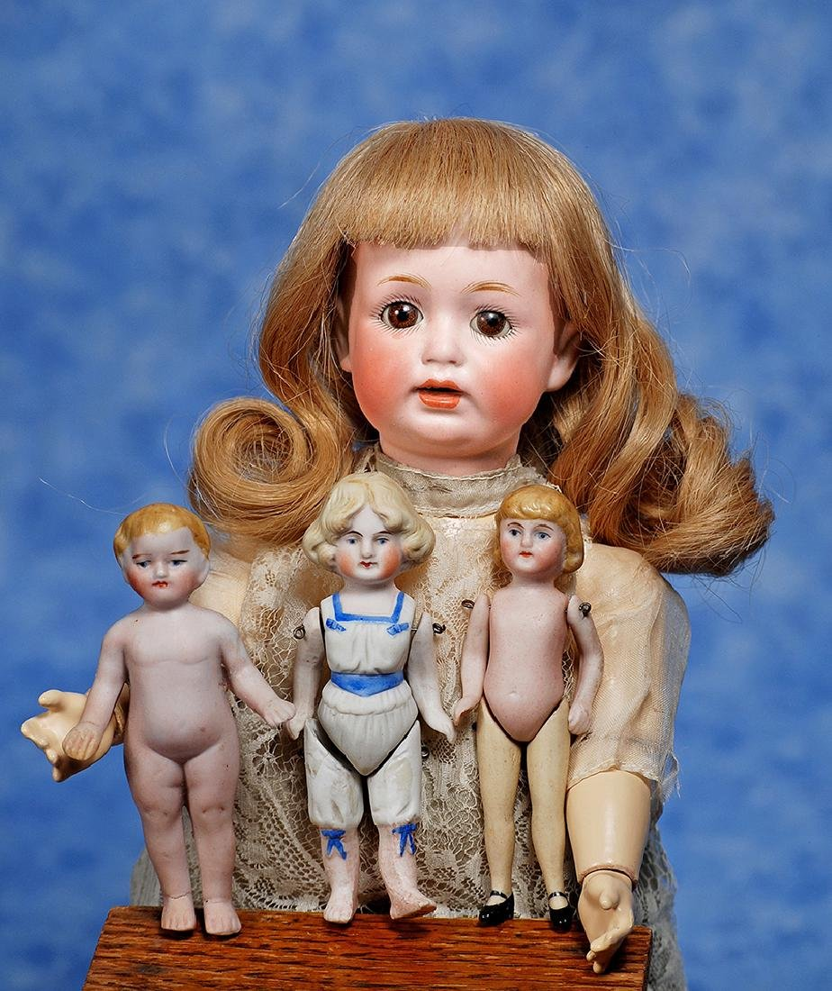 "177. THREE GERMAN ALL-BISQUE DOLLS. 3 ¾"" to"
