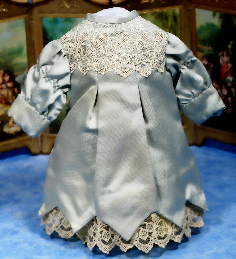 182. BLUE SILK DRESS FOR SMALL DOLL. Pretty pale blue