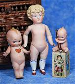 . GERMAN BISQUE KEWPIE WITH WRITING PEN AND STANDING