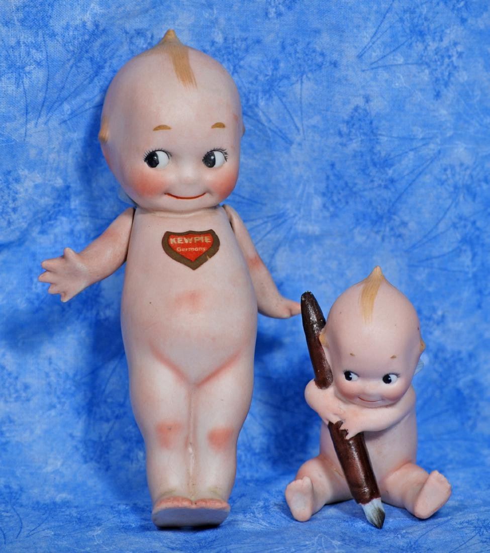 197. GERMAN BISQUE KEWPIE WITH WRITING PEN AND STANDING - 2
