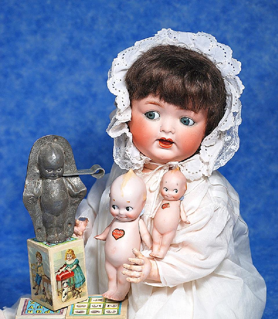 198. TWO GERMAN BISQUE KEWPIES & ANTON REICHE KEWPIE
