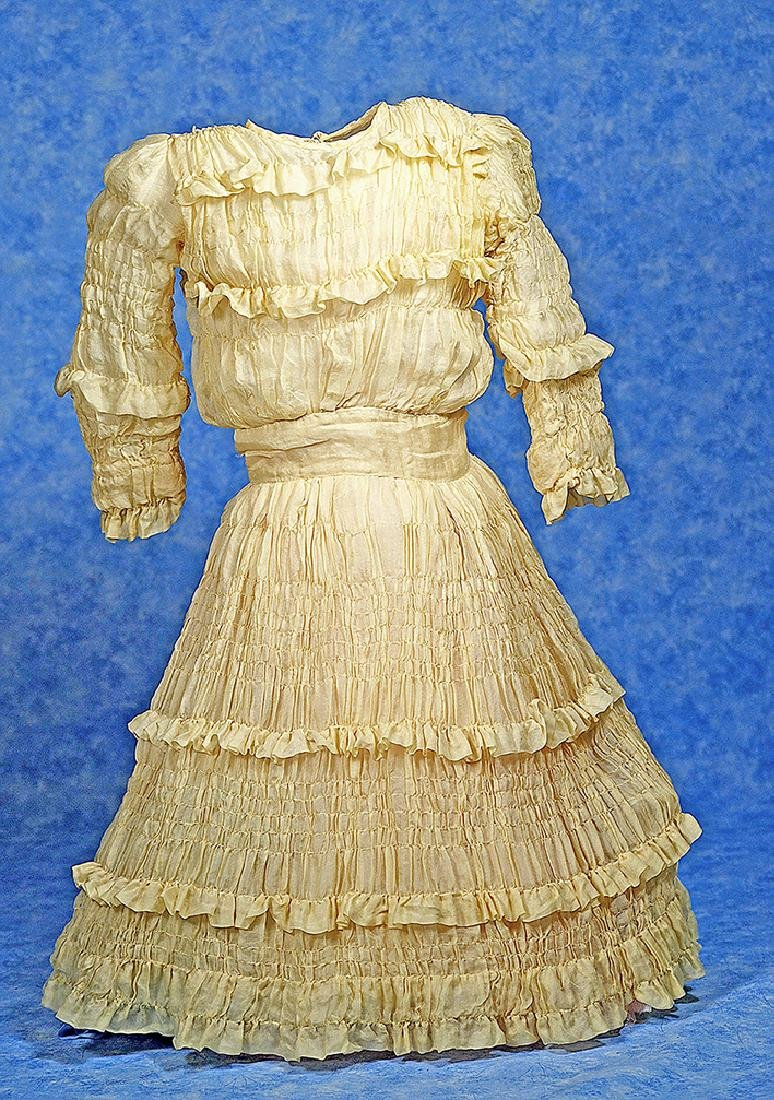 206. ANTIQUE YELLOW SILK DOLL DRESS FOR LARGE DOLLS.