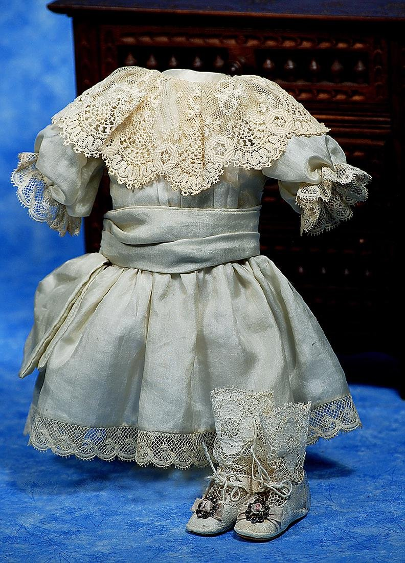 214. SILK DOLL DRESS AND PAIR OF DOLL SHOES. Fine pale