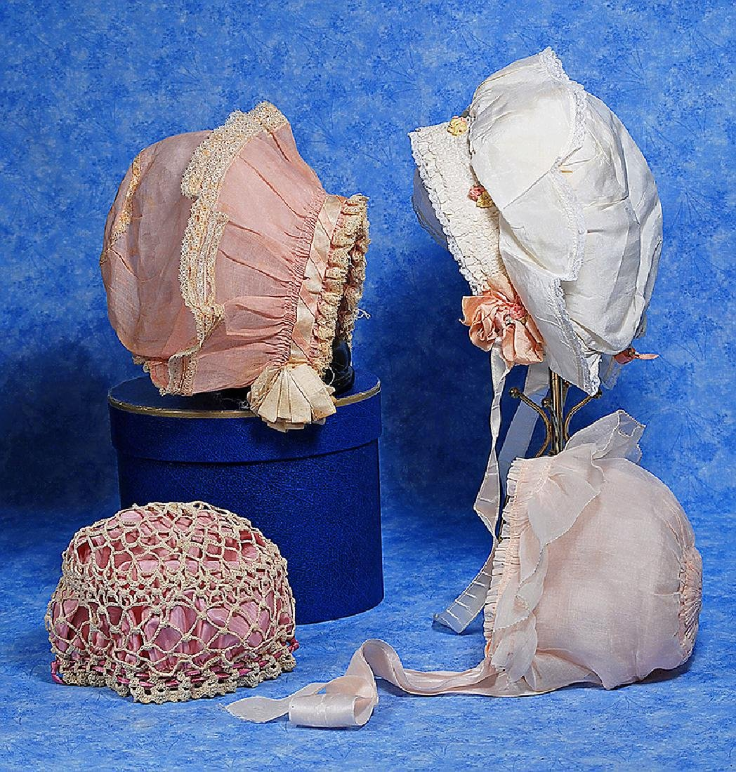 215. FOUR DOLL BONNETS. Includes: Rose pink organdy