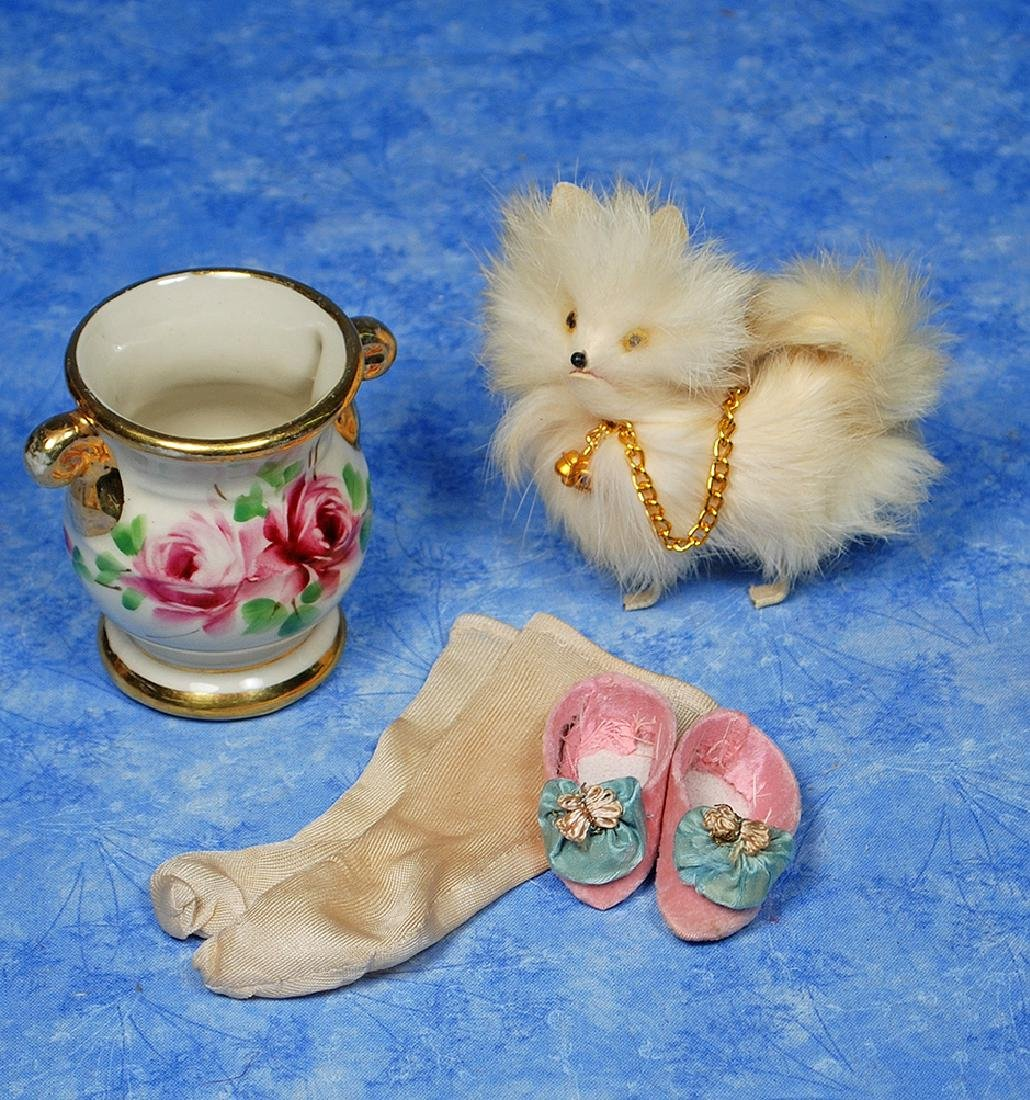230. DOLL ACCESSORIES. Includes: White furry miniature