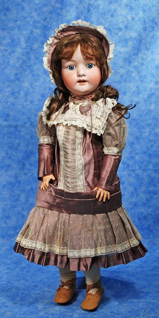 236. GERMAN BISQUE CHILD DOLL BY E. HEUBACH. Marks: