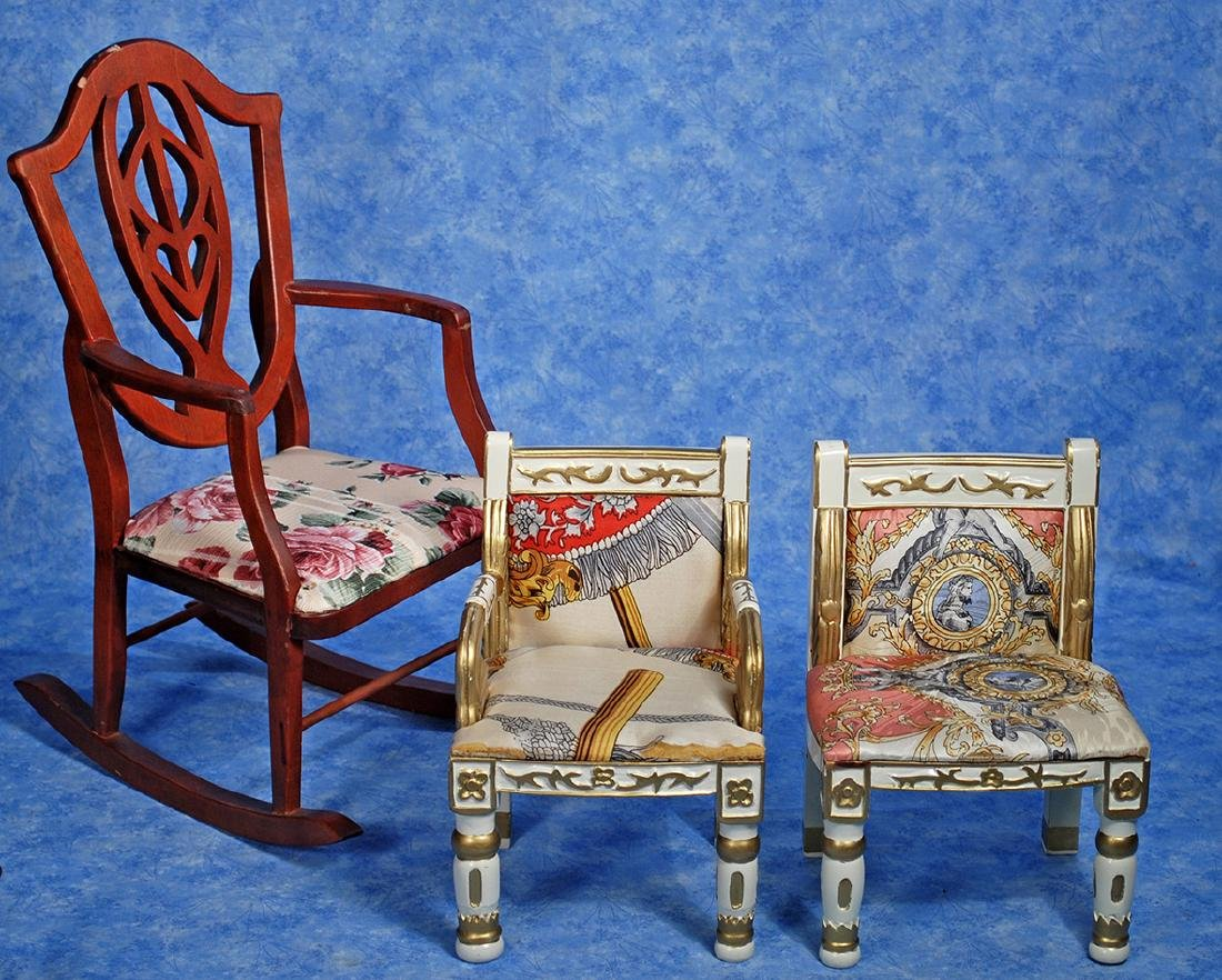 241. TWO GILT-TRIMMED SILK DOLL CHAIRS & DOLL ROCKING