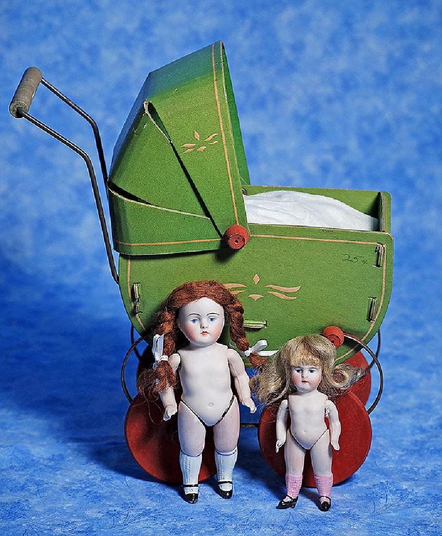 256. TWO GERMAN ALL-BISQUE DOLLS WITH CARRIAGE. Each